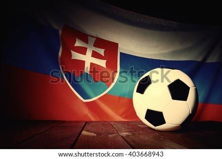 Flag of Slovakia with football on wooden boards as the background. Vintage Style. - stock photo