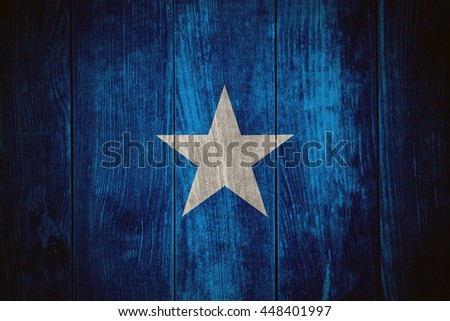 flag of Somalia or Somalian banner on wooden background - stock photo
