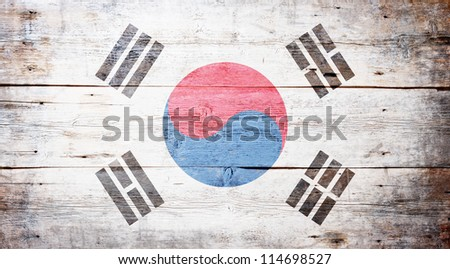Flag of South Korea painted on grungy wood plank background - stock photo