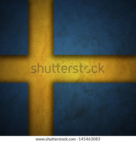 Flag of Sweden. Holes cut on blue grunge wall to show yellow wall behind to form flag of Sweden - stock photo