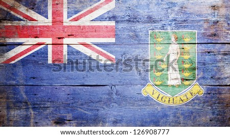 Flag of the British Virgin Islands painted on grungy wood plank background - stock photo