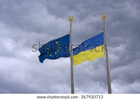 Flag of the EU and Ukraine as a symbol of collaboration - stock photo