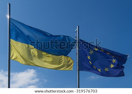 flag of the EU and Ukraine on the flagpole - stock photo