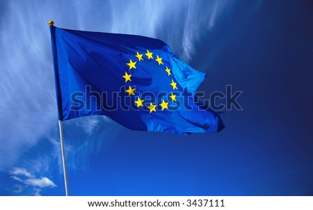 Flag of the european union in front of the deep blue sky. - stock photo