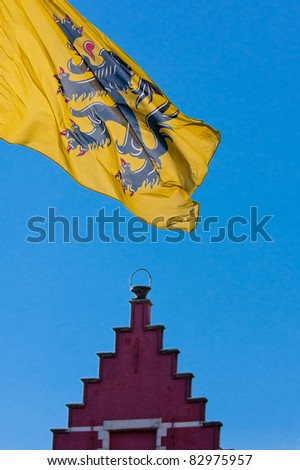 Flag of the Flanders and a roof - stock photo
