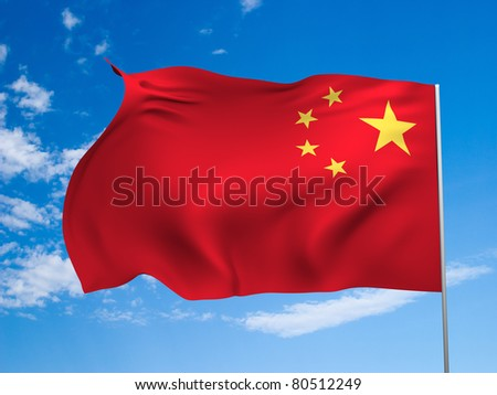 Flag of the People's Republic of China flying in the wind against a blue sky - stock photo