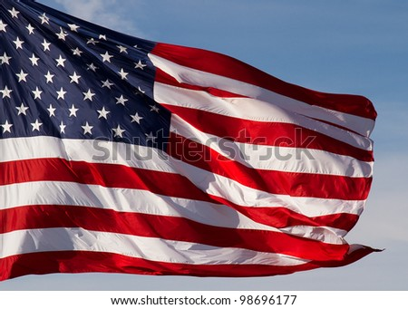 Flag of the United States of America flies in a strong breeze. - stock photo