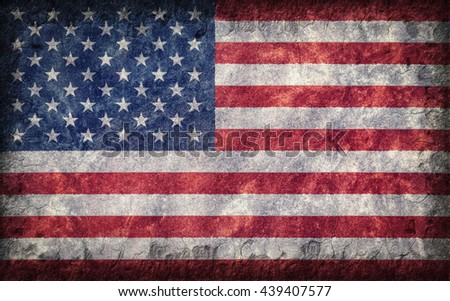 Flag of the United States of America painted onto a rough wall - stock photo