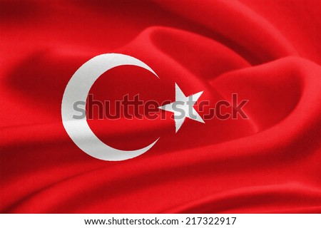 Flag of Turkey waving in the wind. Silk texture pattern - stock photo