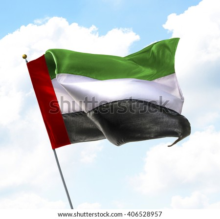 Flag of United Arab Emirates Raised Up in The Sky - stock photo