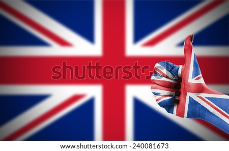 Flag of United Kingdom on hand - stock photo