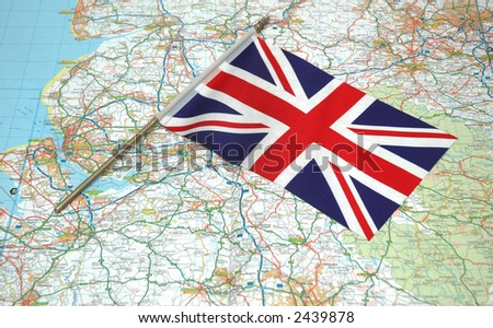 Flag of United Kingdom over the map - stock photo