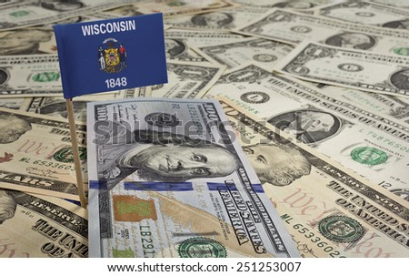Flag of Wisconsin sticking in a variety of american banknotes.(series) - stock photo
