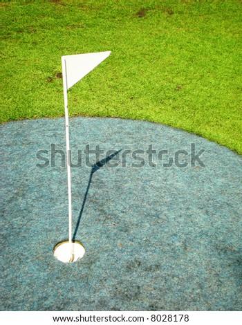 Flag on a golf course - stock photo