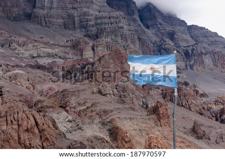Flag on Plaza de Mulas base camp, Aconcagua Mount, Mendoza, Argentina.  - stock photo