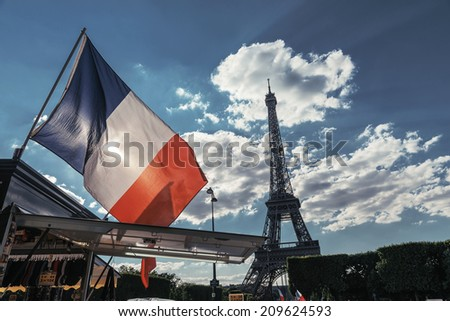 Flag over the Eiffel tower - stock photo