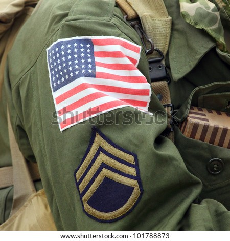 Flag patch on american soldier (Staff Sergeant) uniform. - stock photo