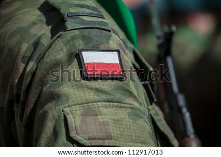 Flag patch on polish soldier uniform - stock photo