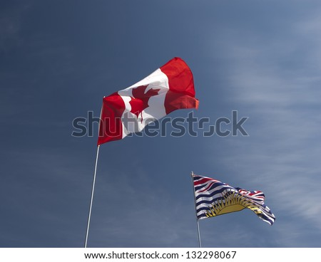 Flags - Canada and British Columbia flags in the wind - stock photo