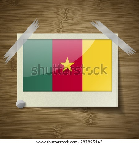 Flags of cameroon at frame on wooden texture.  illustration. Rastrized version - stock photo