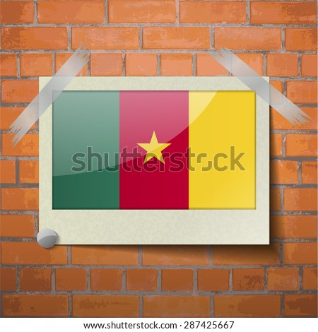Flags of cameroon scotch taped to a red brick wall.  Rasterized version - stock photo