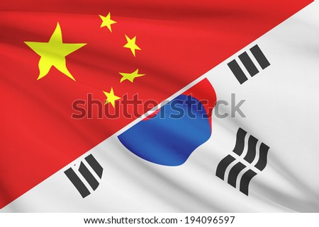 Flags of China and Republic of Korea blowing in the wind (South Korea). Part of a series. - stock photo