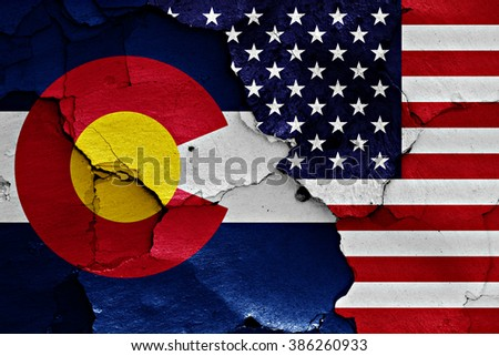 flags of Colorado and USA painted on cracked wall - stock photo