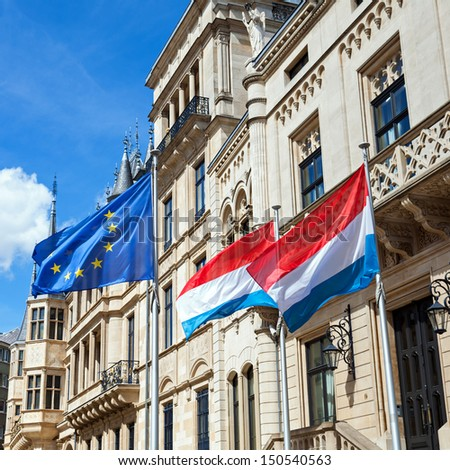 Flags of Europe and Luxembourg in the wind. - stock photo