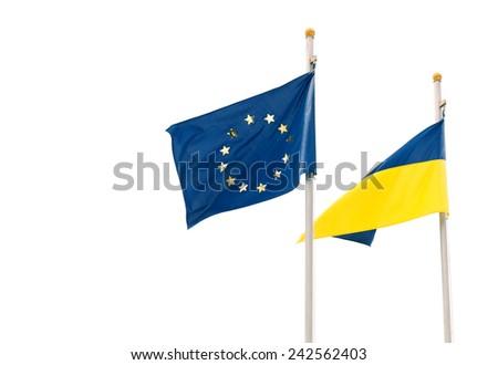 Flags of European Union and Ukraine waving on flagpoles isolated on white background - stock photo