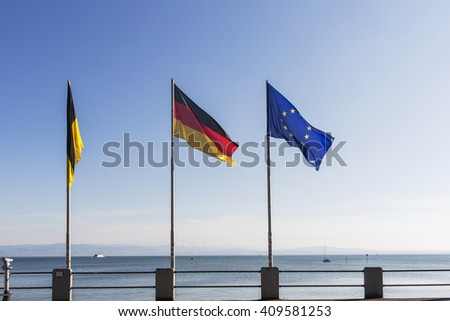 Flags of Germany and Europe at Lake Constance in Friedrichshafen harbor. GERMANY - stock photo