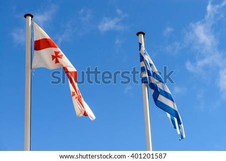 flags of Greece and Georgia on the background of the sky - stock photo