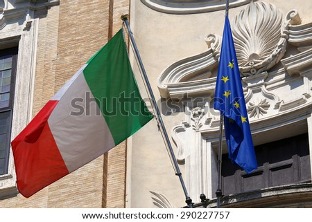 Flags of Italy and European Union waving in Rome, Italy - stock photo