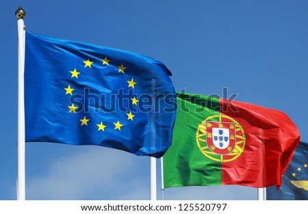 Flags of Portugal and EU in the sun - stock photo