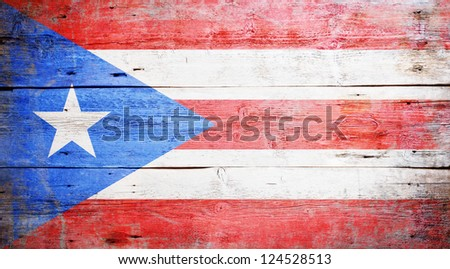 Flags of Puerto Rico painted on grungy wood plank background - stock photo