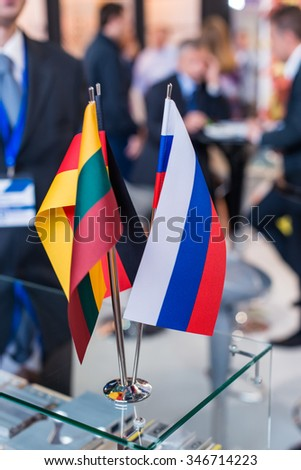 flags of Russia, Germany, Lithuania (shallow DOF; color toned image) - stock photo