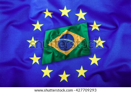 Flags of the Brasil and the European Union. Brasil Flag and EU Flag. Brasilian Flag inside stars. World flag concept. - stock photo