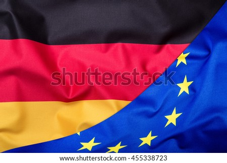 Flags of the Germany and the European Union. Germany Flag and EU Flag. World flag money concept. - stock photo