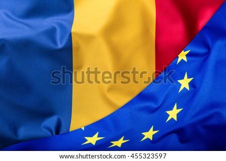 Flags of the Romania and the European Union. Romanian Flag and EU Flag. World flag money concept. - stock photo