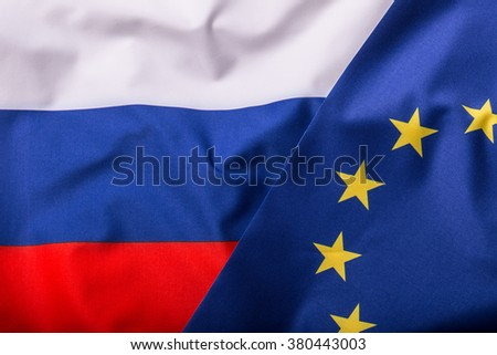 Flags of the Russia and the European Union. Russia Flag and EU Flag. World flag money concept. - stock photo