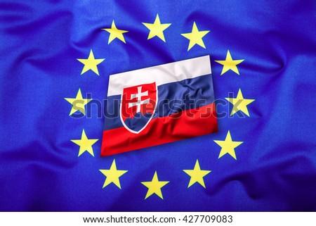 Flags of the Slovak republic and the European Union. Slovakia Flag and EU Flag. Flag inside stars. World flag concept. - stock photo