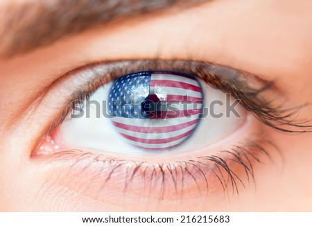 Flags of the USA in beautiful female eye  - stock photo
