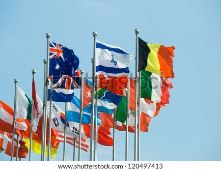 Flags of the world happily blowing in the wind. - stock photo