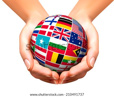Flags of the world in globe and hands.  - stock photo