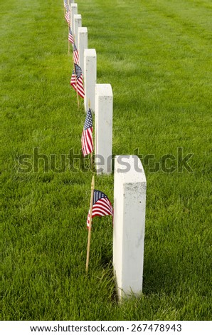 Flags placed at the final resting graves of USA military veterans during Memorial Day - stock photo
