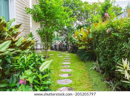 Flagstone path in home garden - stock photo