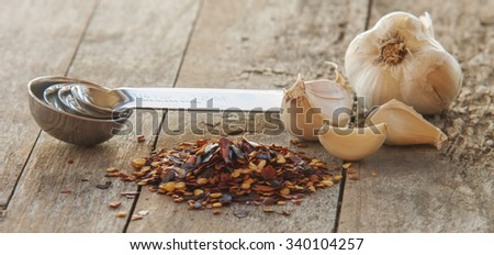 Flakes of red hot chili peppers with garlic - stock photo