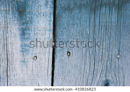 Flaking blue paint on old wooden boards close-up - stock photo
