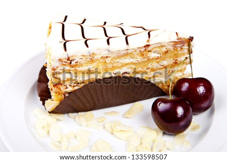 Flaky cake with cherries and almond on white background - stock photo