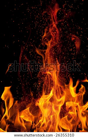 flame and sparks isolated over black background - stock photo