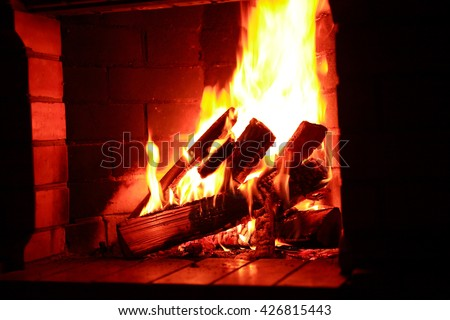 Flame background. Firewood burning in fireplace - stock photo